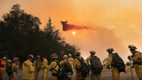 Teams report progress against wildfires, but new figures show more death, destruction