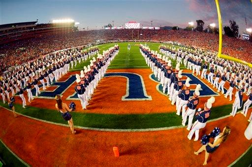 The Auburn band takes the field before the NCAA BCS National Championship college football game against Florida State Monday, Jan. 6, 2014, in Pasadena, Calif.