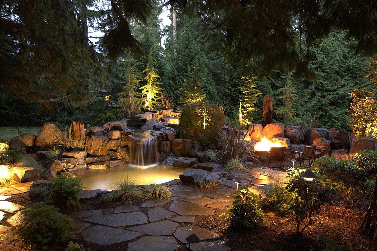 This Sammamish project was completed by Alderwood Landscaping. The total project cost was $95,000.  (Image: Water Feature and Firepit / Porch.com)