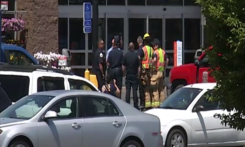 Police and firefighters outside the Walmart in Lebanon, Oregon, on Thursday, June 29, after reports of a possible pipe bomb triggered an evacuation. (SBG)
