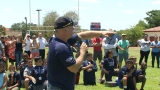 Garth Brooks, local athletes spend day at football camp for kids in San Antonio