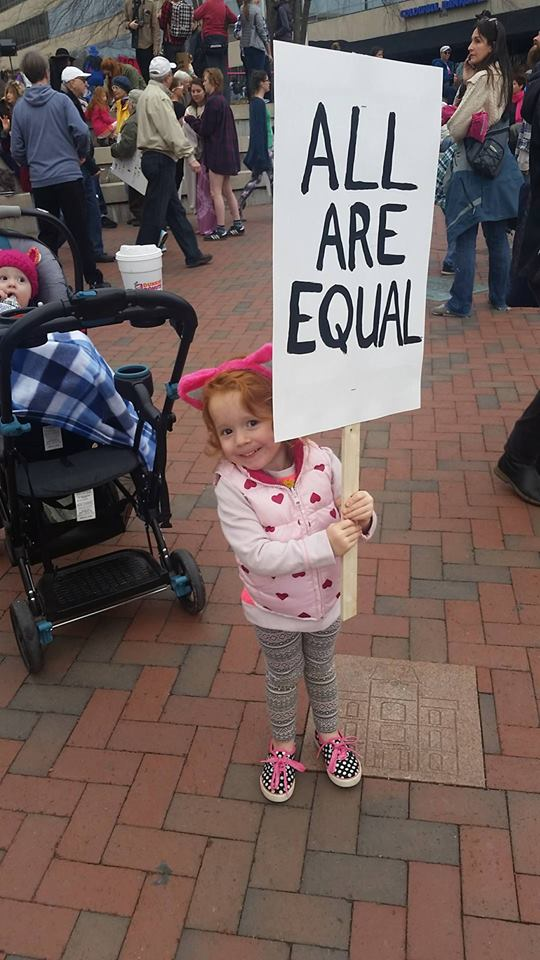 Thousands of people showed up for the rally and march on Saturday, many wearing pink knit hats and carrying signs. Asheville police estimated the crowd at six to seven thousand participants. (Photo credit: WLOS staff)