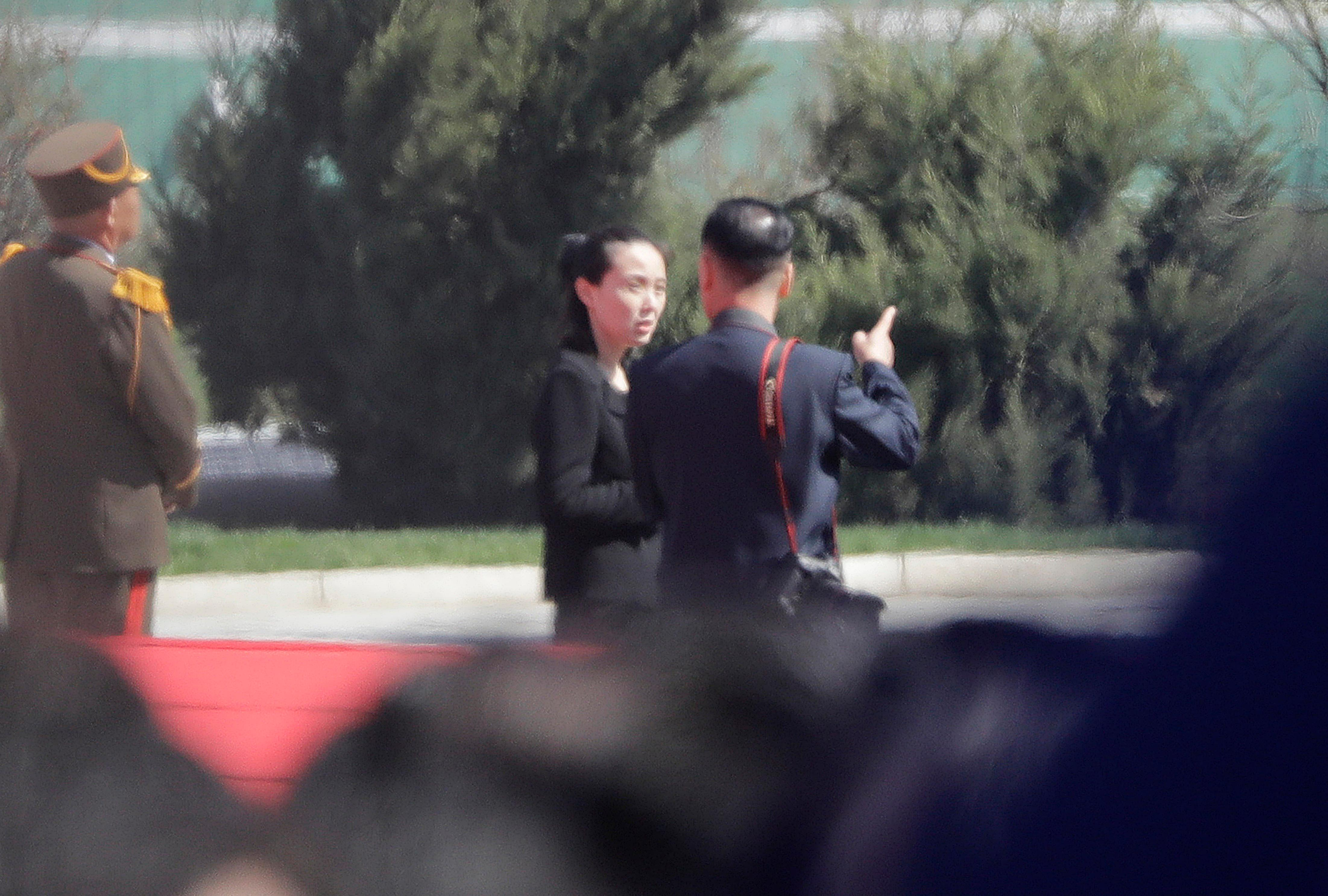 In this April 13, 2017, photo, Kim Yo Jong, center, sister of North Korean leader Kim Jong Un, is pictured during the official opening of the Ryomyong residential area, a collection of more than a dozen apartment buildings, in Pyongyang, North Korea. South Korea's Unification Ministry said North Korea informed Wednesday, Feb. 7, 2018, that Kim Yo Jong would be part of the high-level delegation coming to the South for the Pyeongchang Winter Olympics. (AP Photo/Wong Maye-E)