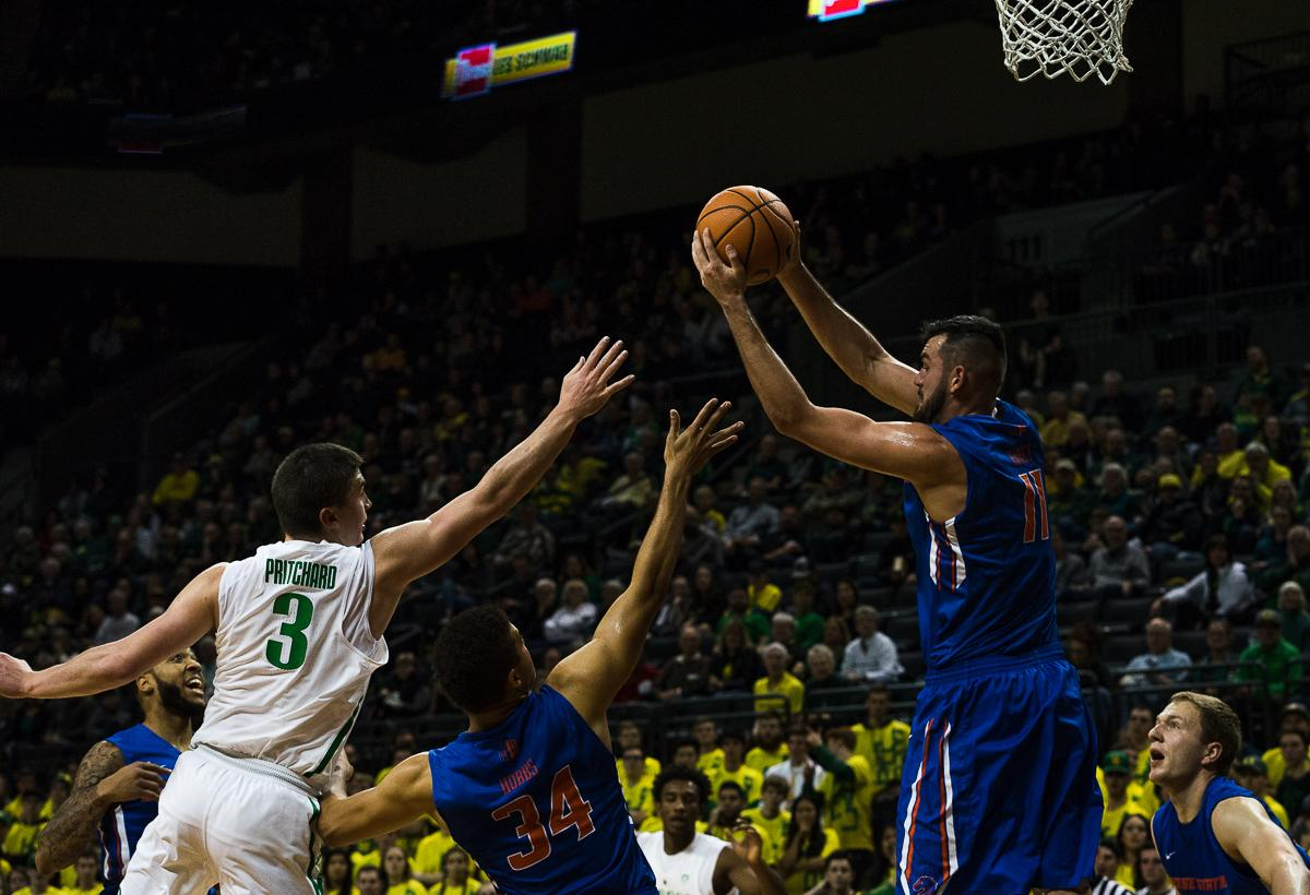 Boise State Bronco Zach Haney (#11) recovers the ball as teammate Alex Hobbes (#34) keeps University of Oregon Duck Payton Pritchard (#3) away. The Boise State Broncos defeated the University of Oregon Ducks 73 – 70 at Matthew Knight Arena in Eugene, Ore., on December 1, 2017. Photo by Kit MacAvoy, Oregon News Lab