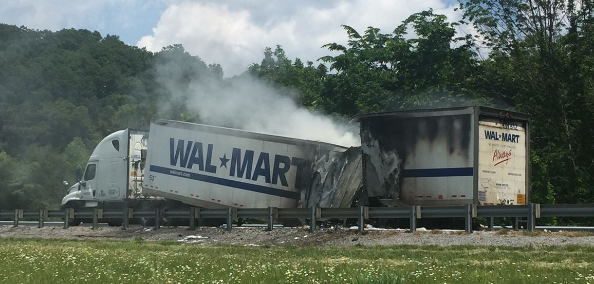 The remains of a Walmart tractor trailer lay along lanes on Interstate 81 northbound in Sullivan County, Tennessee following a crash involving bikers from the 'Run for The Wall' event on Wednesday. (K. Roberts, WCYB)<p></p>