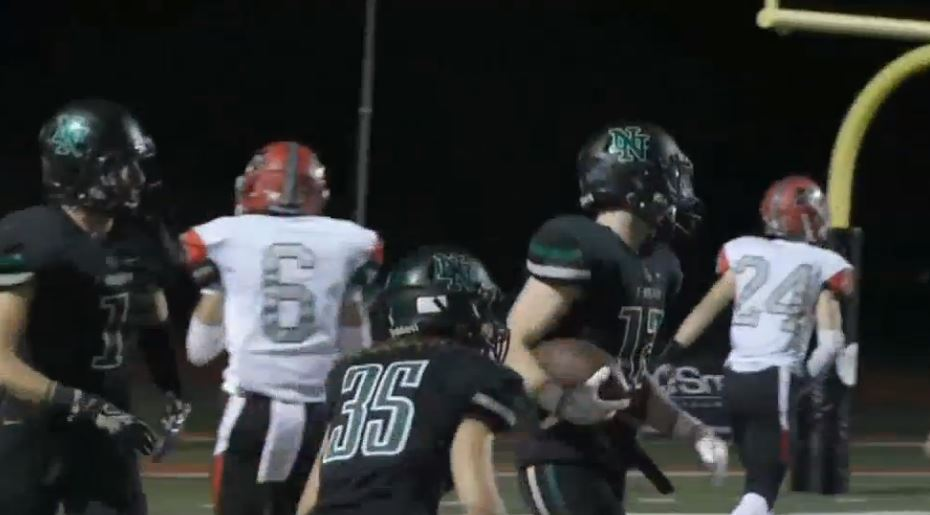 Drake Stoops, with the ball after a touchdown, had three touchdowns in the first half of Norman North game against Mustang on Friday, Sept. 30, 2016 (KOKH)