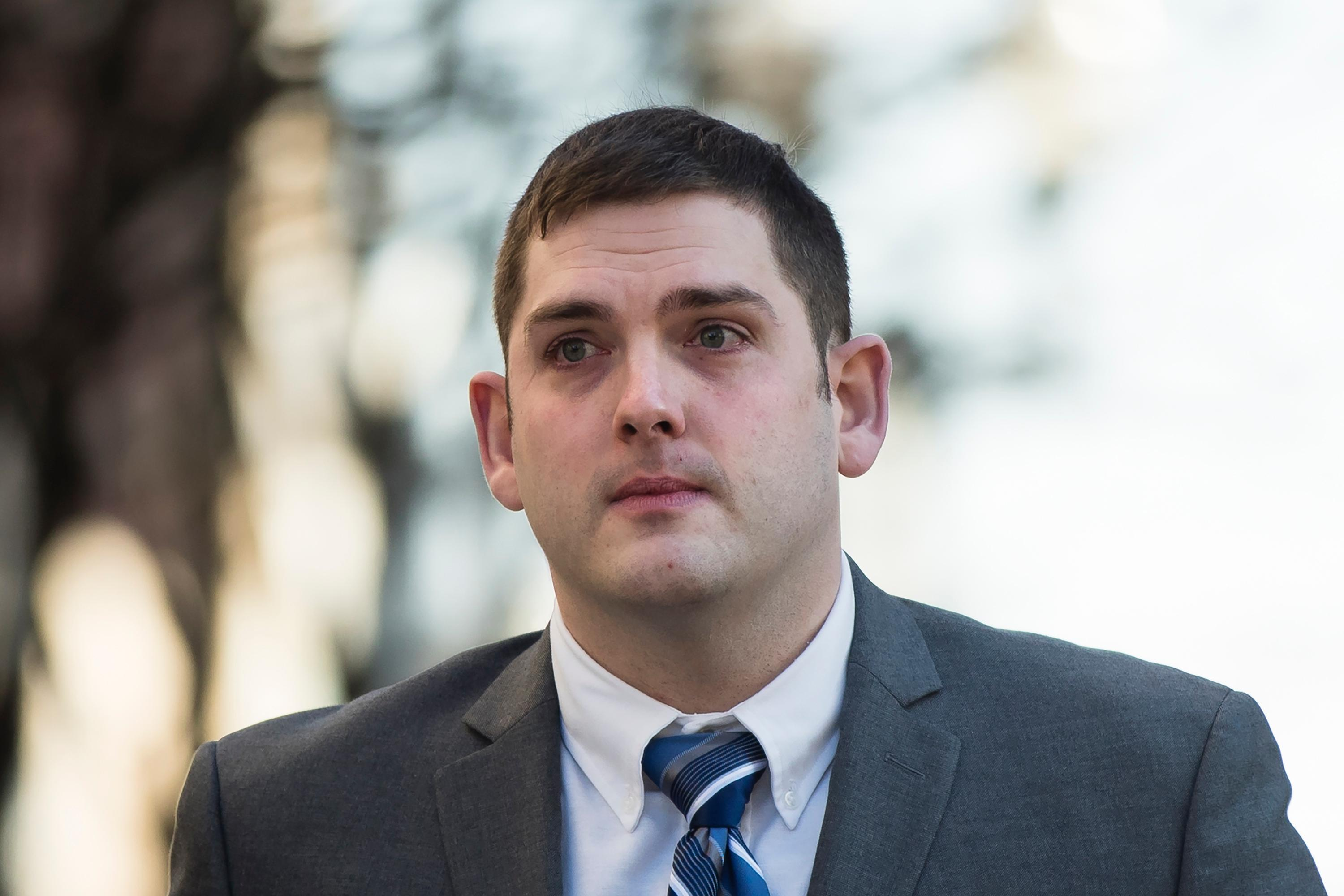 In this March 12, 2019 file photo, former East Pittsburgh police officer Michael Rosfeld, charged with homicide in the shooting death of Antwon Rose II, walks to the Dauphin County Courthouse in Harrisburg, Pa. (AP Photo/Matt Rourke)