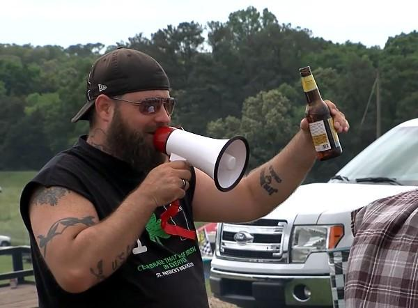 A NASCAR fan talks through a bull horn on the campgrounds at Talladega Superspeedway.