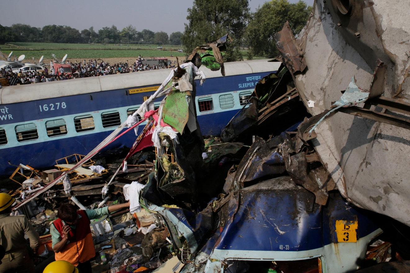 Rescuers work on the site of a train derailment accident in Kanpur Dehat, India, Sunday, Nov. 20, 2016. Many were killed Sunday when 14 coaches of an overnight passenger train rolled off the track in northern India, with rescue workers using cutting torches to try to pull out survivors, police said. (AP Photo/Rajesh Kumar Singh)
