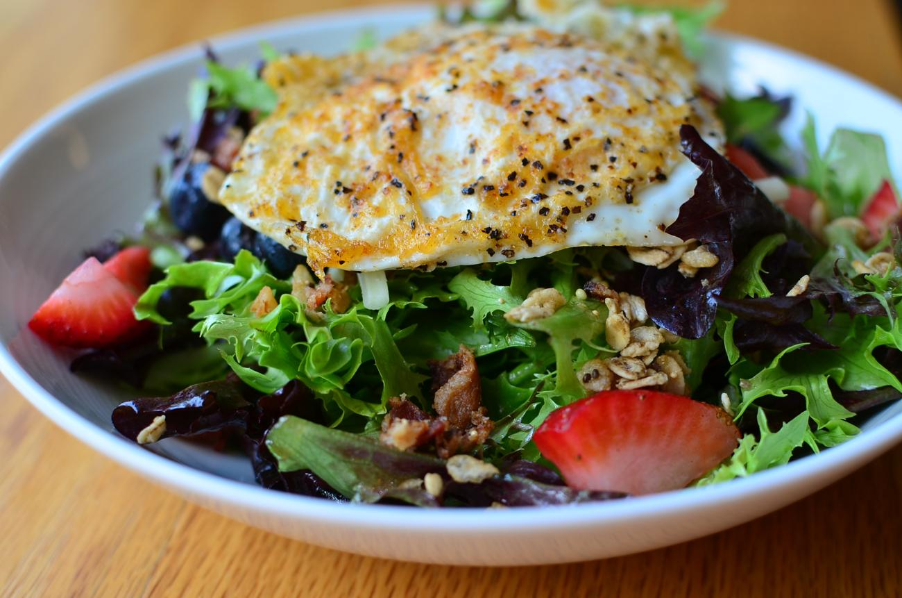 Press House Salad: mixed greens, strawberry, blueberry, granola, bacon, egg over easy, cheddar, and maple vinaigrette / Image: Leah Zipperstein, Cincinnati Refined // Published: 9.6.17
