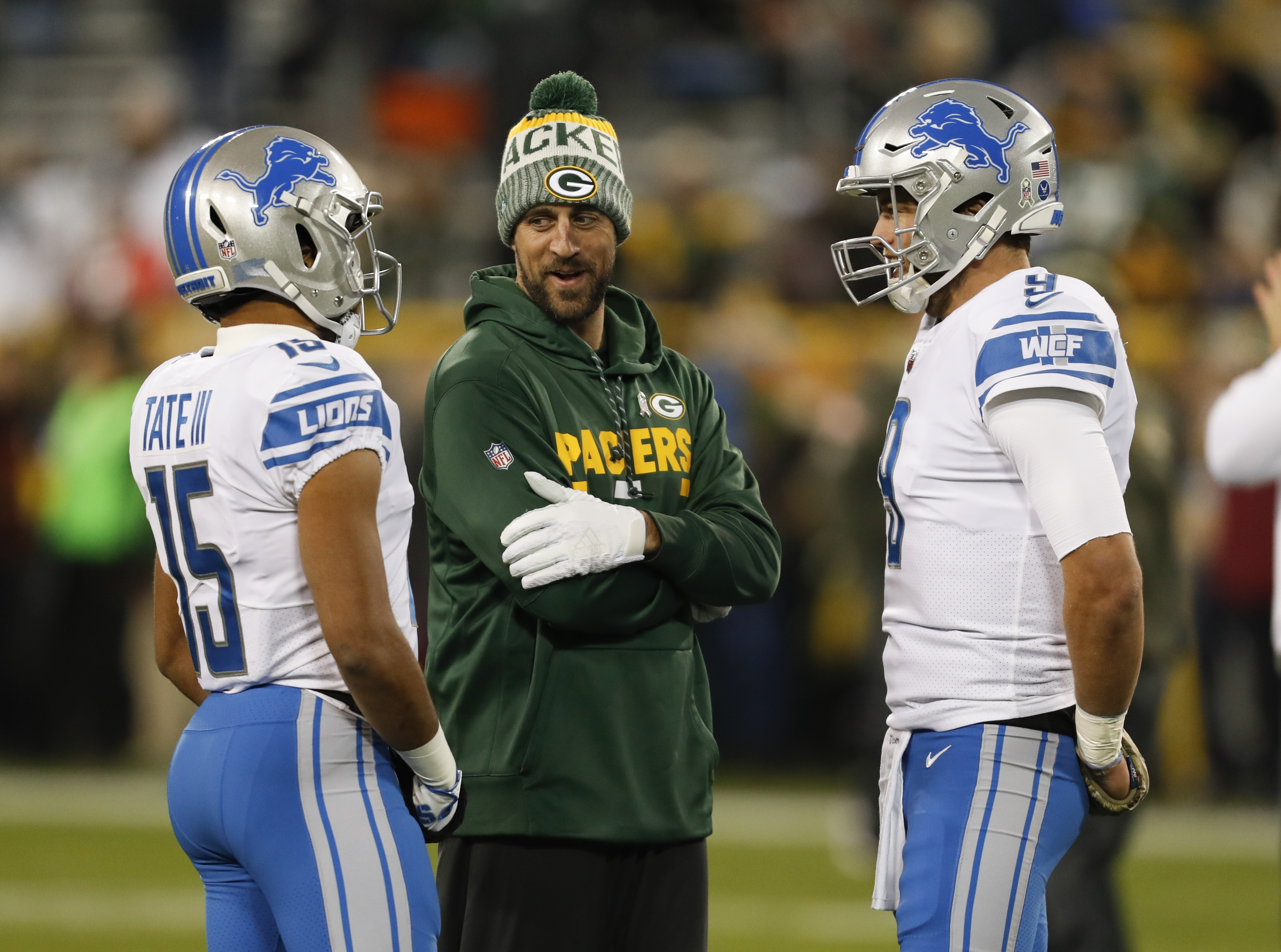 Green Bay Packers' Aaron Rodgers talks to Detroit Lions' Golden Tate and Matthew Stafford before a game Monday, Nov. 6, 2017, in Green Bay. (AP Photo/Matt Ludtke)