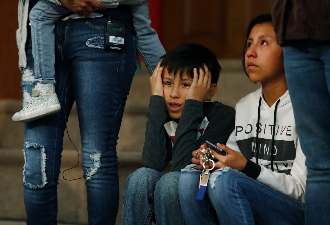 Roberto Vizguerra, center, and his sister, Luna, right, sit next to their mother, Jeanette, left, a Mexican woman seeking to avoid deportation from the United States, during a news conference in a church in which the Vizguerra and her children have taken refuge Wednesday, Feb. 15, 2017, in Denver. U.S. immigration authorities have her request to remain in the country. (AP Photo/David Zalubowski)
