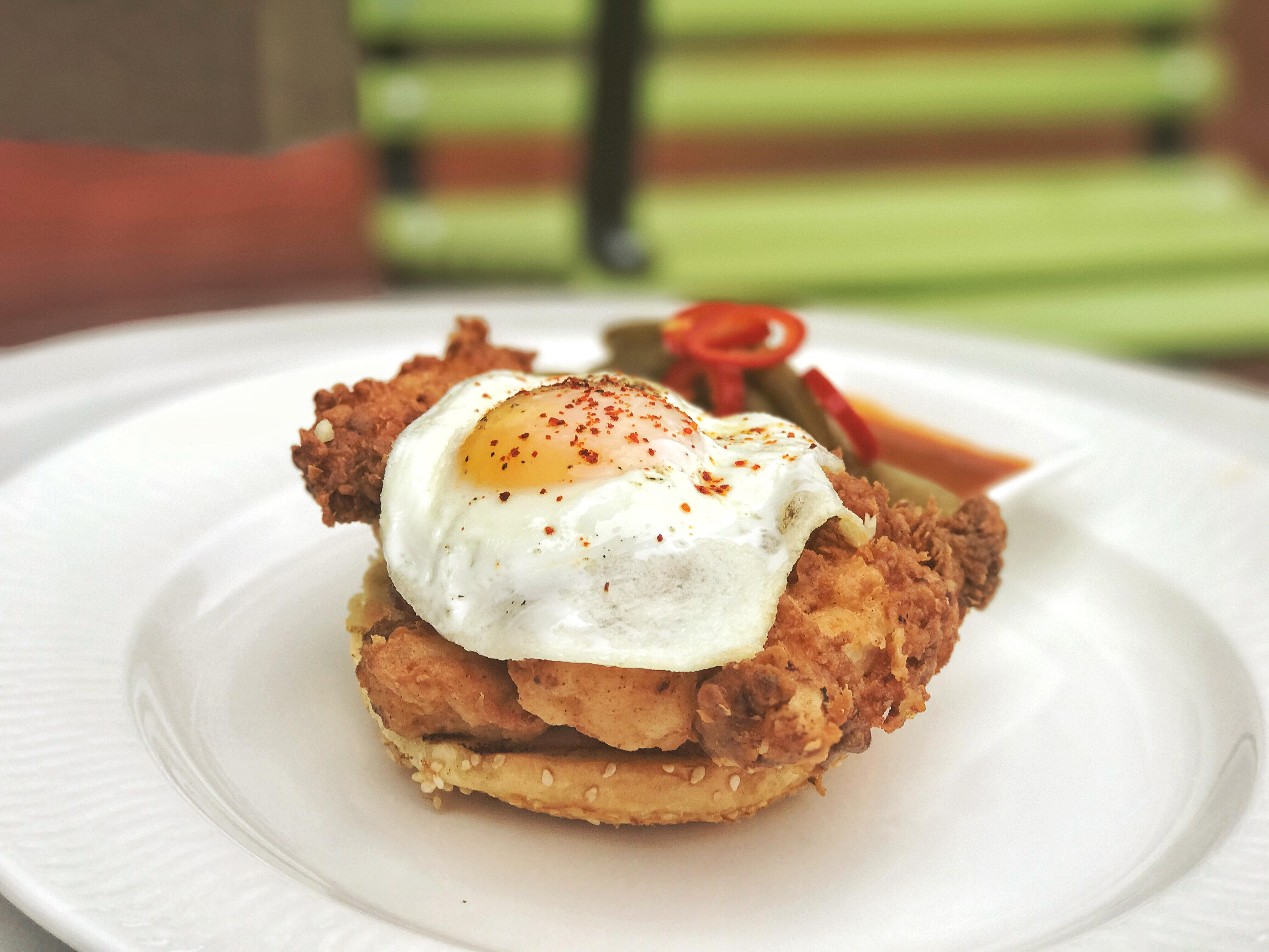 Poultry is the star attraction at this Logan Circle roost, so naturally the breakfast sandwich features an organic fried chicken thigh, plus an egg, Thai chili mayo, and pickles ($13). (Image: Courtesy The Bird)